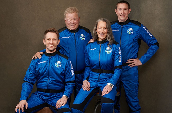 The four member Blue Origin crew (from R) Glen de Vries, Audrey Powers, Canadian actor William Shatner and Chris Boshuizen posing at an undisclosed location on 10 October 2021.