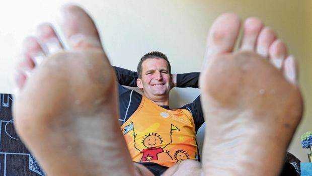 Graham Wells rests his feet in preparation for running the Comrades Marathon barefoot for the Starfish Greathearts Foundation.