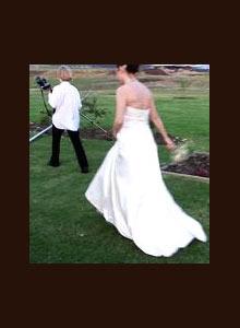 <b>A wedding photographer leads the bride away for portraits as the sun sets. (Johann van Tonder)</b>