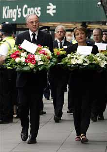 <b>London mayor Ken Livingstone and culture secretary Tessa Jowell arrive to lay flower tributes at King's Cross Station in remembrance of those killed in last year's bombings. (Sang Tan, AP)</b>