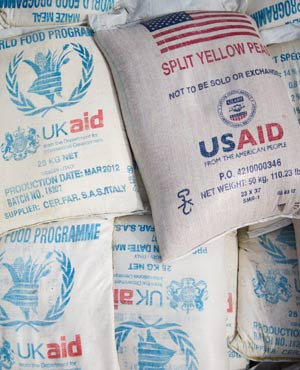 Sacks of food aid from the World Food Programme donated by the United Kingdom and the United States. (Phil Moore, AFP)