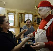 <b>'Tis the season... Larry Stewart gives money to strangers in need. (M Spencer Green, AP)</b>
