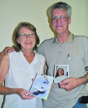 Marie and Swannie Swanepoel show a photo of their daughter Tessa Beetga. (The Witness)