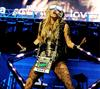 Ke$ha dons a crazy, lumo get-up for her performance.