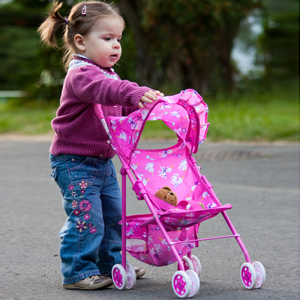 Little girl and her pram