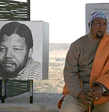 <b>Zwelivelile Mandela next to a portrait of his grandfather at the Mvezo open-air museum. (News24)</b>
