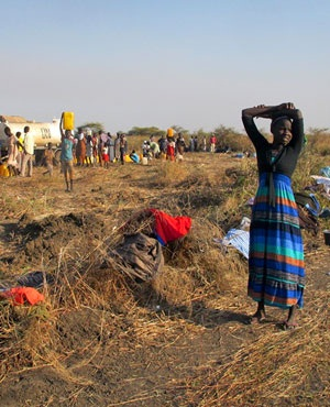 A displaced woman stands by her washing at the UN compound where she has sought shelter in Bentiu, in oil-rich Unity state, in South Sudan. (File, AP)