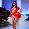 Miranda Kerr swops outfits for a racy red number.
