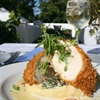 Crusted chicken breast filled with blue cheese, honey roasted apple and orange butter sauce