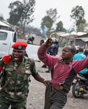 News24.com | DRC policewoman arrested for killing 14-year-old protester