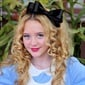 How cute is child star Kathryn Newton's Alice in Wonderland costume? We're in love with the big black bow that tops her blonde ringlets!