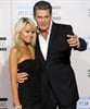 David Hasselhoff poses on the carpet with his girlfriend.