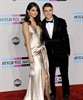 Teen sensations Justin Bieber and Selena Gomez pose together on the carpet.