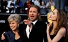 Brad Pitt, his mom Jane and Angelina Jolie joke around on the red carpet at the Oscars. (Matt Sayles, AP)