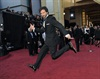 Flight of the Concords member Bret McKenzie arrives at the 84th Academy Awards in Los Angeles. (Chris Pizzello, AP)