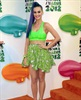 Katy Perry rocks the colour of the awards show's signature slime as she arrives.