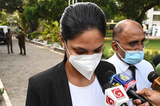 """Former Mrs. Sri Lanka 2019 and current Miss World Caroline Jurie leaves Cinnamon Gardens Police Station after being released on bail in Colombo on 8 April 2021 following her arrest on charges of assault over an on-stage fracas in which she pulled the crown off the head of the new """"Mrs Sri Lanka""""."""