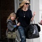Kate Winslet's daughter, Mia, uses mom as a shield from prying eyes and a chunky knit sweater — complete with a stylish shawl collar and wide sleeves — as a shield from the New York cold.