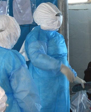 Medical workers of the John Fitzgerald Kennedy hospital of Monrovia wearing a protective suit work at the high-risk area of the hospital, the surgical section where Ebola patients are being treated. (AFP)
