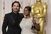 Octavia Spencer poses backstage with previous winner Christian Bale.
