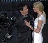 <i>Iron Man</i> co-stars Robert Downey Jr and Gwyneth Paltrow put on a show for the cameras.