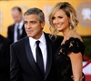 George Clooney and Stacey Keibler walk the carpet. (AP)