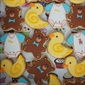 <strong><a href='http://pinterest.com/pin/159033430561022843/'>Baby themed biscuits.</a></strong> Ducks, bears and little baby grows are enough to up any baby shower's cute factor.