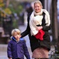 The Boadwalk Empire star, Gretchen Mol, holds on tight to her new baby Winter Morgan Williams while walking with her son Ptolemy. The family calls New York City home.