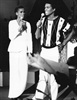 """In this July 25, 1984, file photo, Whitney Houston and Jermaine Jackson sing during a rehearsal for the CBS television soap opera """"As the World Turns"""" in New York."""