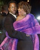 In this March 25, 2001 file photo, Bobby Brown and his then wife Whitney Houston arrive at Vanity Fair's Oscar party at Morton's in Hollywood.