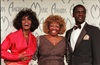 Whitney Houston celebrates her win at the American Music Awards with her mother, Cissy, and brother, Gary, at the Shrine Auditorium in LA on January 26, 1998.
