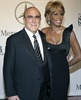 Whitney Houston and music producer Clive Davis arrive at the 17th Carousel of Hope Ball benefiting the Barbara Davis Center for Childhood Diabetes in Beverly Hills on October 28, 2006.