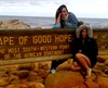 Shakira and a friend are seen at the southern most point of Africa where the Atlantic Ocean and Indian Ocean meet.