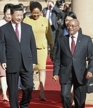 Chinese President Xi Jinping walks with South African President Jacob Zuma upon his arrival at the Union Buildings in Pretoria, on Wednesday (December 2 2015). Picture: Sydney Seshibedi/ Reuters
