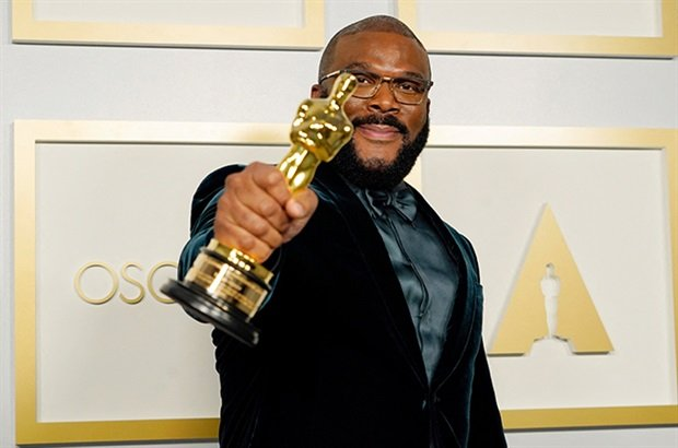 <p>Tyler Perry, winner of the Jean Hersholt Humanitarian Award, poses in the press room during the Oscars.</p><p></p>