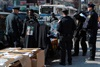 Police kick out Whitney Houston memorabilia vendors outside the Apollo Theatre in Harlem in New York City. (Ilya S. Savenok, Getty Images)