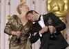 Oscar winners Meryl Streep and Jean Dujardin find comfort on each other's shoulders after accepting their Oscars for Best Actress and Actor.