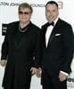 Elton John and his partner David Furnish are all smiles for the cameras at their annual post-Oscars soiree.