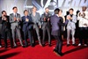 Life of the party, Robert Downey Jr, rushes to his castmates for their group photos.
