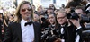 Brad Pitt took to the red carpet without his fiancee Angelina Jolie at the premiere of his latest movie <em>Killing Them Softly</em> at the 65th Cannes Film Festival. (Photos: AP)