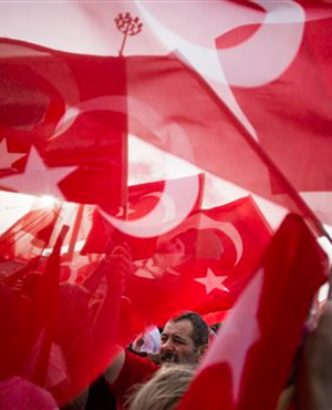 Turkish flags fly in the wind during a demonstration on Taksim Square in Istanbul, Turkey. (Gero Breloer, AP)