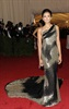 The <i>Vampire Diaries</i> star glammed it up in this shiny, flowy number. (Photo: Evan Agostini, AP)