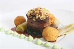 Roast Gemsbok, green peppercorn gel, sliced nuts, glazed chicory and potato puffs.