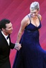 A very pregnant Reese Witherspoon is escorted up the steps by her Mud co-star Matthew McConaughey.