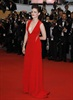 Kristen Stewart comes out to support boyfriend Robert Pattinson at the premiere of his new movie Cosmopolis, wearing a sexy red Reem Acra creation.