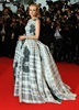Cannes jury member Diane Kruger attends the festival closing ceremony in a bulbous black and white plaid ballgown.