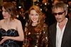Australian pop star Kylie Minogue is glittering in gold at the premiere of her new French movie Holy Motors. (Photo: AFP)