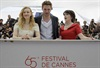 The awkward Robert Pattinson pose parade continues as he attends the Cosmopolis photocall with co-stars Sarah Gadon (left) and Emily Hampshire.