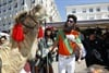 Sacha Baron Cohen sparked minor chaos on Cannes' fabled Croisette beachfront as his zany alter ego General Aladeen took a morning stroll on his camel Osama, to promote his new comedy The Dictator.