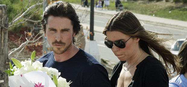 Christian Bale and his wife Sibi Blazic visit a memorial to the victims of Friday's mass shooting, in Aurora, Colorado. (AP Photo/Ted S. Warren)